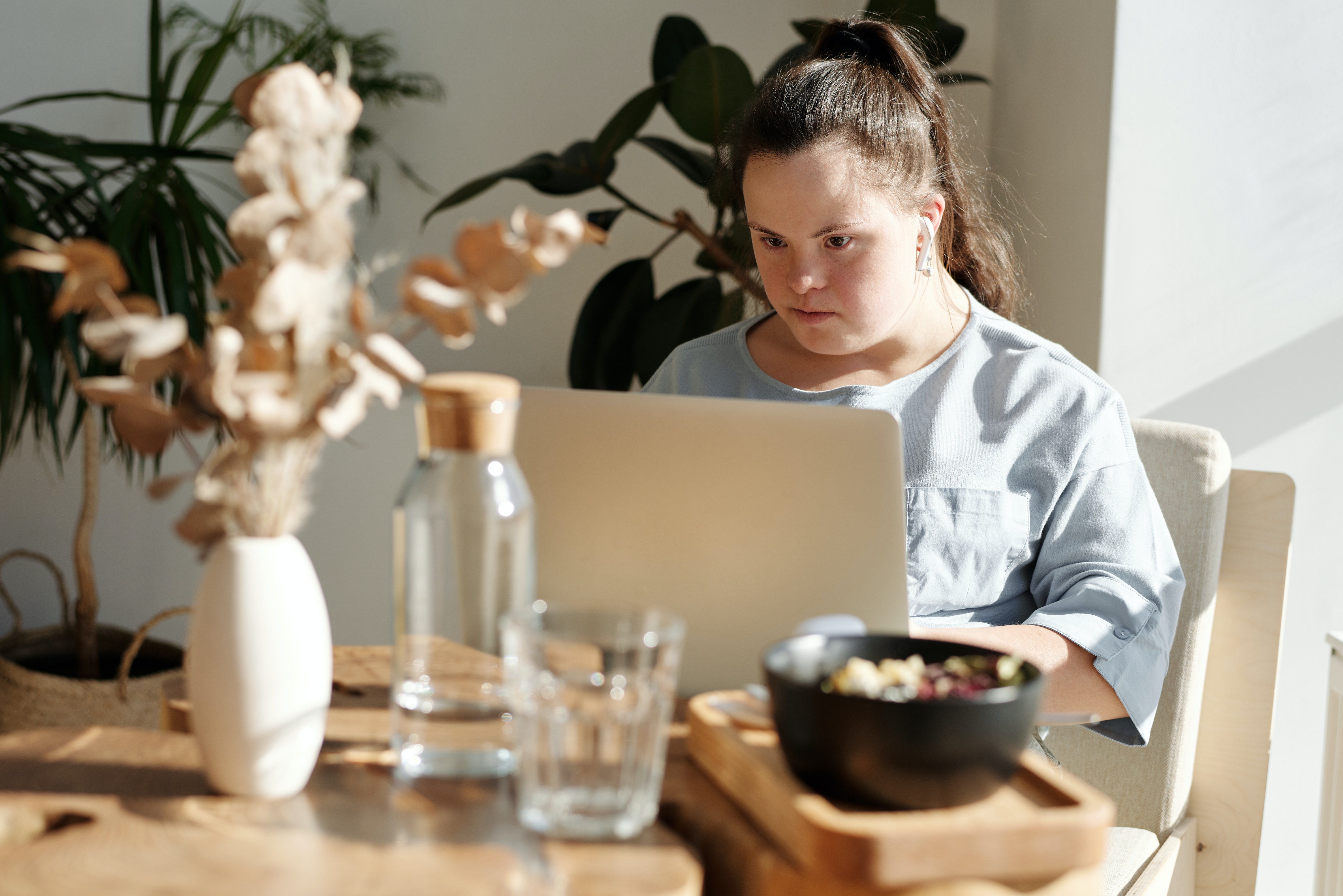 Adult with Down syndrome working